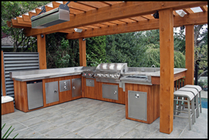 elements outdoor kitchen modules shown with U-Shaped kitchen with backsplash and raised bar overhang Jackson Grills Premier 850 built in Access doors, paper towel holder, trash bin, outdoor fridge, 2 double drawer sets Built in cocktail/sink station, double searing burner, stereo speakers and overhead outdoor heater Granite counter top with wood paneling Backsplash, raised bar, and under-counter overhangs finished in heavy-duty stainless steel